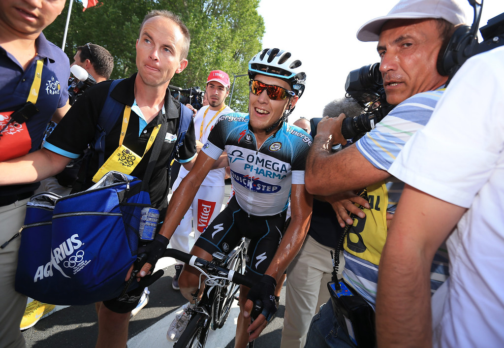 . LYON, FRANCE - JULY 13:  Matteo Trentin of Italy and Omega Pharma-Quickstep celebrates winning stage fourteen of the 2013 Tour de France, a 191KM road stage from Saint-Pourcain-sur-Sioule to Lyon, on July 13, 2013 in Lyon, France.  (Photo by Doug Pensinger/Getty Images)