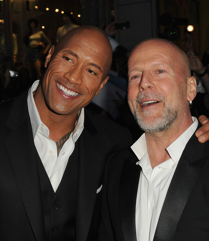 ". Actors Dwayne Johnson and Bruce Willis attend the premiere of Paramount Pictures\' ""G.I. Joe:Retaliation\"" at TCL Chinese Theatre on March 28, 2013 in Hollywood, California.  (Photo by Kevin Winter/Getty Images)"