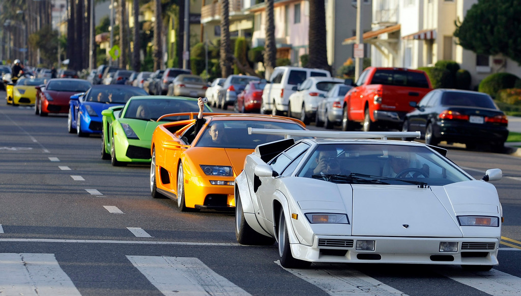 . A white 1986 Lamborghini Countach joins a convoy of 30 Lamborghinis leaving Santa Monica Beach in on their way to an inaugural opening ceremony of the Automobili Lamborghini Boutique at Westfield Topanga Shopping Center on Wednesday, Dec. 2, 2009, in Santa Monica, Calif. (AP Photo/Damian Dovarganes)