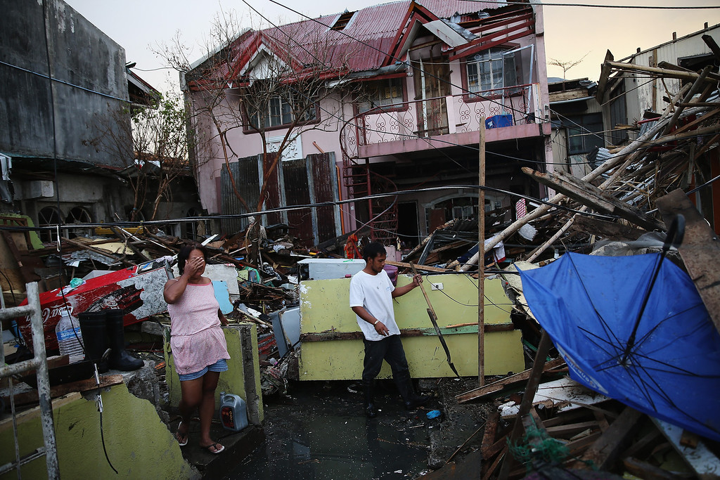 . A family begin to clean their home in Tacloban on November 21, 2013 in Leyte, Philippines.   (Photo by Dan Kitwood/Getty Images)