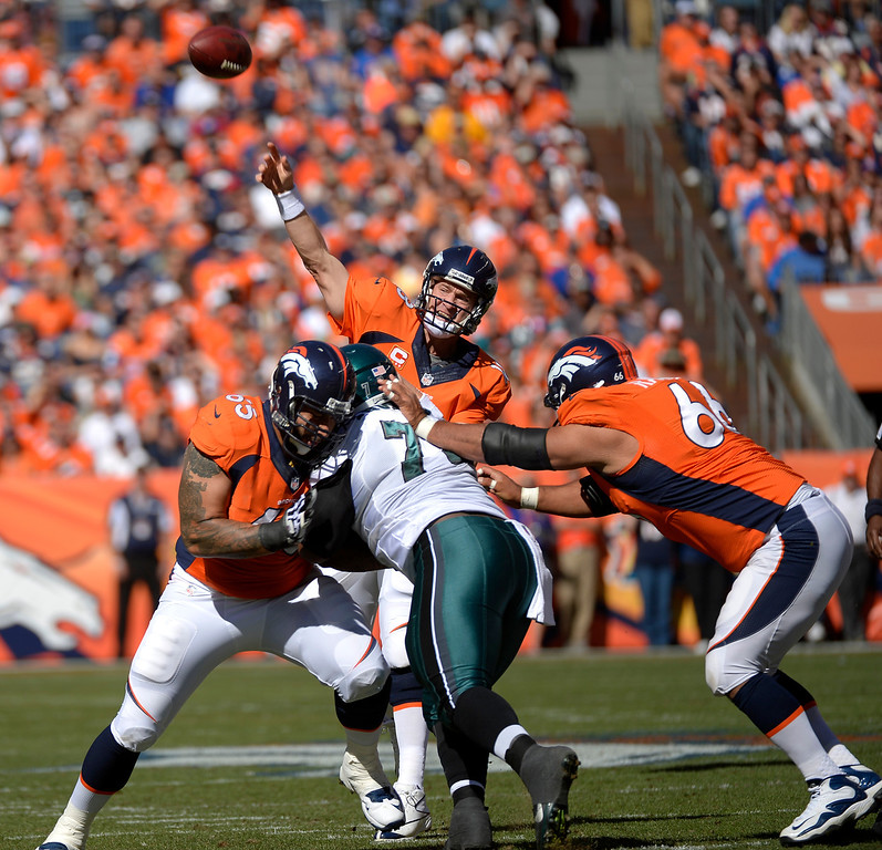 . Denver Broncos quarterback Peyton Manning (18) drops back to throw on a the first drive of the game. (Photo by Joe Amon/The Denver Post)