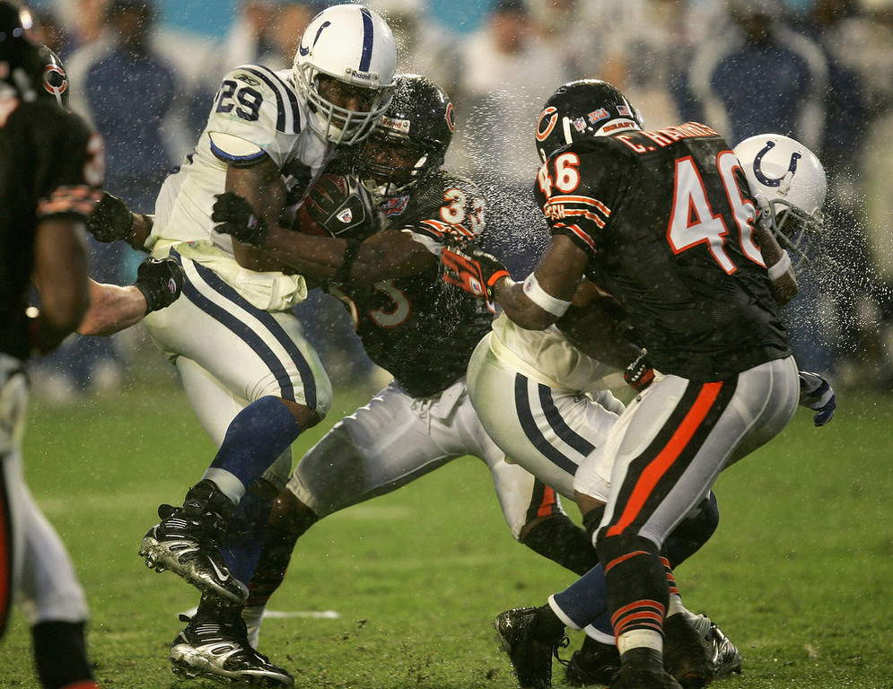 . Joseph Addai #29 of the Indianapolis Colts is hit while running the ball by Charles Tillman #33 of the Chicago Bears during Super Bowl XLI on February 4, 2007 at Dolphin Stadium in Miami Gardens, Florida. The Colts won 29-17. (Photo by Jonathan Daniel/Getty Images)