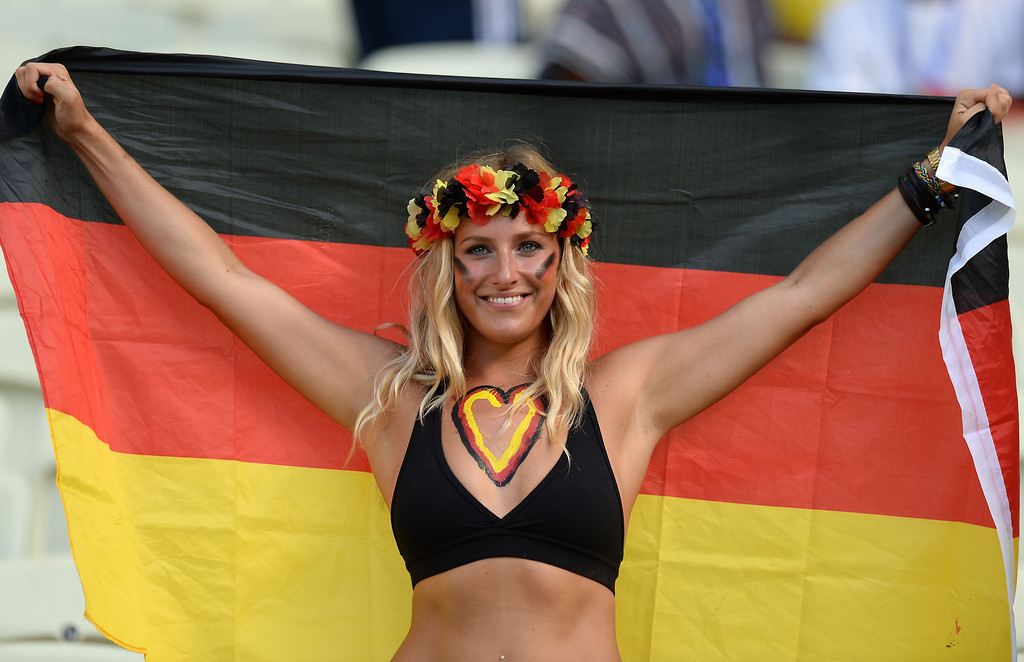 . A German supporter cheers prior to a Group G football match between Germany and Ghana at the Castelao Stadium in Fortaleza during the 2014 FIFA World Cup on June 21, 2014. CARL DE SOUZA/AFP/Getty Images