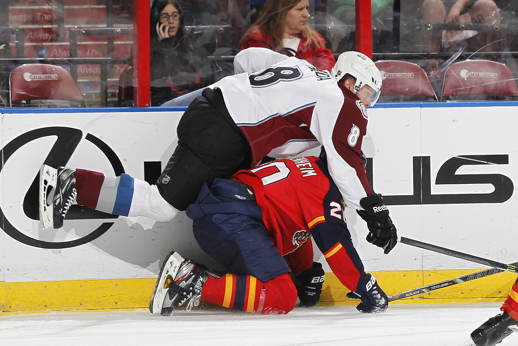 . SUNRISE, FL - JANUARY 24: Jan Hejda #8 of the Colorado Avalanche checks Sean Bergenheim #20 of the Florida Panthers to the ice during first period action at the BB&T Center on January 24, 2014 in Sunrise, Florida. (Photo by Joel Auerbach/Getty Images)