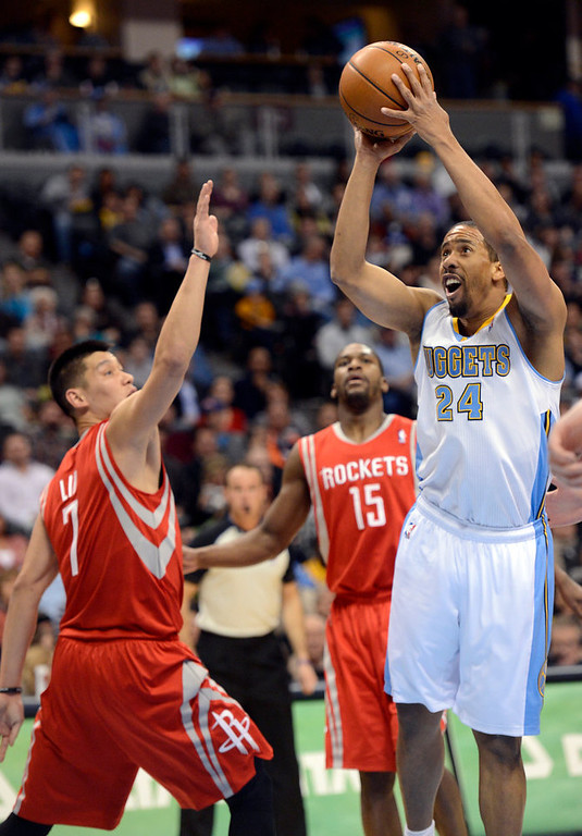 . DENVER, CO. - JANUARY 30: Denver Nuggets point guard Andre Miller (24) takes a shot over Houston Rockets point guard Jeremy Lin (7) during the second quarter January 30, 2013 at Pepsi Center. The Denver Nuggets take on the Houston Rockets in NBA action. (Photo By John Leyba/The Denver Post)