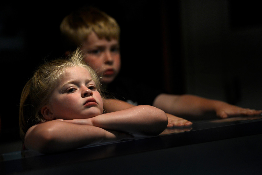 . PUEBLO, CO. - May 24: 5 year old Sorrel Unwin waits for her food with her 8 year old brother Wilder in the snack bar of the Mesa Drive In. Their mother Gina said she and her family have been coming here forever. May 24, 2013 Pueblo, Colorado. (Photo By Joe Amon/The Denver Post)