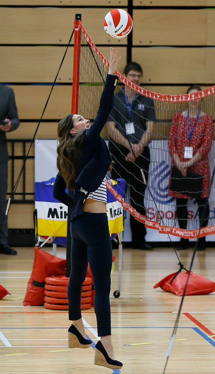 . Britain\'s Kate, The Duchess of Cambridge plays volleyball during a visit to a SportsAid Athlete Workshop, at the Queen Elizabeth Olympic Park in London, Friday, Oct. 18, 2013.  (AP Photo/Kirsty Wigglesworth)