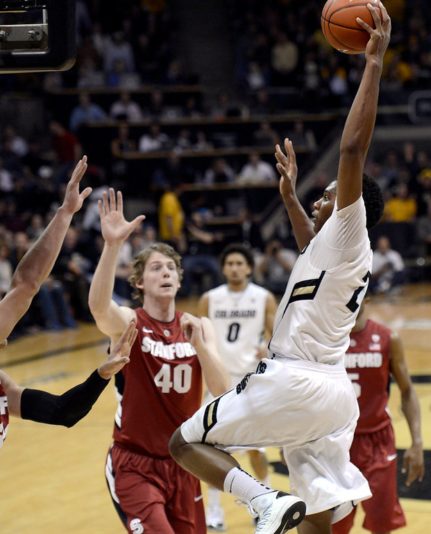 . University of Colorado\'s Xavier Johnson goes big for a dunk over John Gage, No. 40, and a swarm of other defenders during a game against Stanford on Thursday, Jan. 24, at the Coors Event Center on the CU campus in Boulder. Jeremy Papasso/ Camera