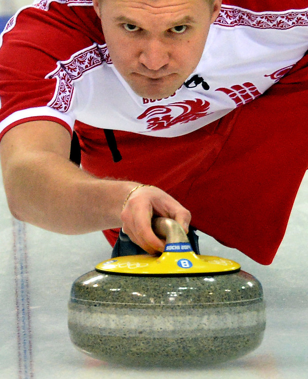 . Russia\'s Alexey Stukalskiy throws the stone during the men\'s curling round robin session 2 match between Denmark and Russia at the Ice Cube curling centre in Sochi on February 10, 2014 during the 2014 Sochi winter Olympics.   YURI KADOBNOV/AFP/Getty Images