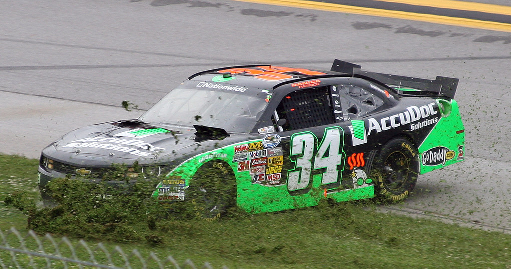 . Danica Patrick slides through the grass in Turn 3 after crashing during the NASCAR Nationwide Series auto race at the Talladega Superspeedway in Talladega, Ala., Saturday, May 4, 2013. (AP Photo/Dale Davis)