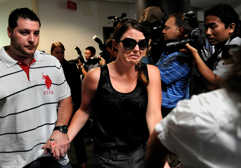 . Amanda Medek cries as she is led through a gauntlet of photographers on her way to the courtroom to witness a hearing for James Holmes, the man accused of killing 12 people, including Medek\'s sister, Micayla, and injuring 58 others. Holmes appeared before Arapahoe County District Court Judge William B. Sylvester on Monday, July 23, 2012 for an advisement hearing. Joe Amon, The Denver Post
