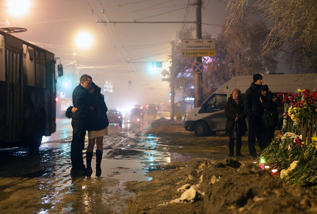 . People grieve at the site of the second terrorist explosion happened on a trolleybus, at a street in Volgograd, Russia. According to media reports, at least 31 people were killed and many were injured in two suicide bombing attack in the city during the last two days.  EPA/MAXIM SHIPENKOV