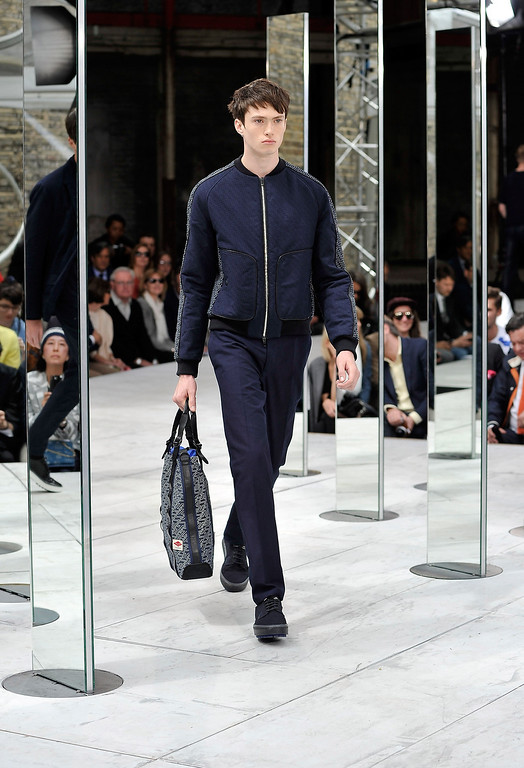. A model walks the runway at the rag & bone show during the London Collections: MEN SS14 at Farmiloe Building on June 17, 2013 in London, England.  (Photo by Gareth Cattermole/Getty Images)