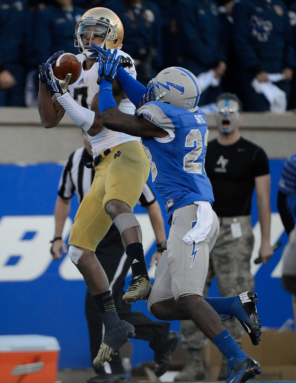 . COLORADO SPRINGS, CO - OCTOBER 26: Notre Dame WR, TJ Jones, left, catches a pass from QB, Tommy Rees for a touchdown against Air Force DB, Steffon Batts, in the third quarter at Falcon Stadium, Saturday afternoon, October 26, 2013. (Photo By Andy Cross/The Denver Post)