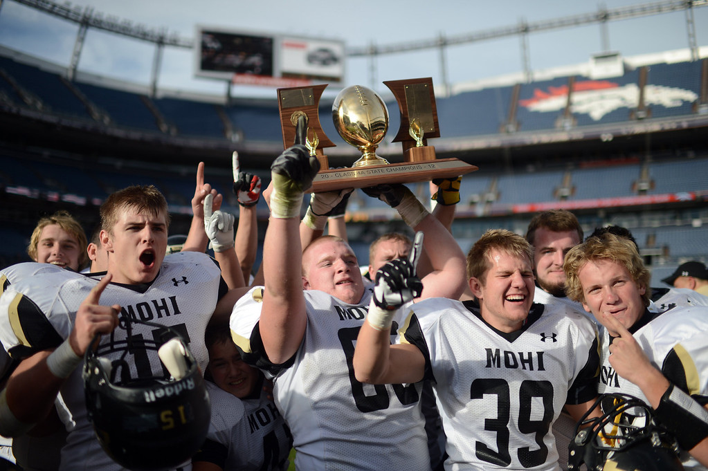 . Monarch High School football team celebrate winning of 4A State Championship game against Denver South at Sports Authority Field at Mile High on Saturday, Dec. 1, 2012. Monarch won 17-14. Hyoung Chang, The Denver Post