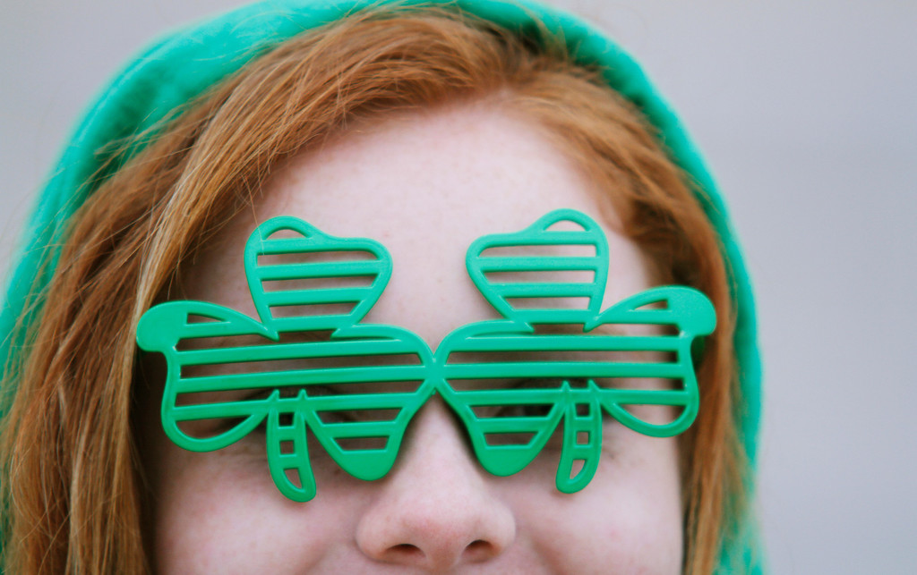 . Jozee Killoren of Hartford, Wis.  looks through her shamrock glasses before the start of the Shamrock Shuffle 5K Race/Walk in Hartford on Saturday, March 16, 2013. Proceeds from the race benefited the Hartford Union Varsity Club.  (AP Photo/The Daily News, John Ehlke)