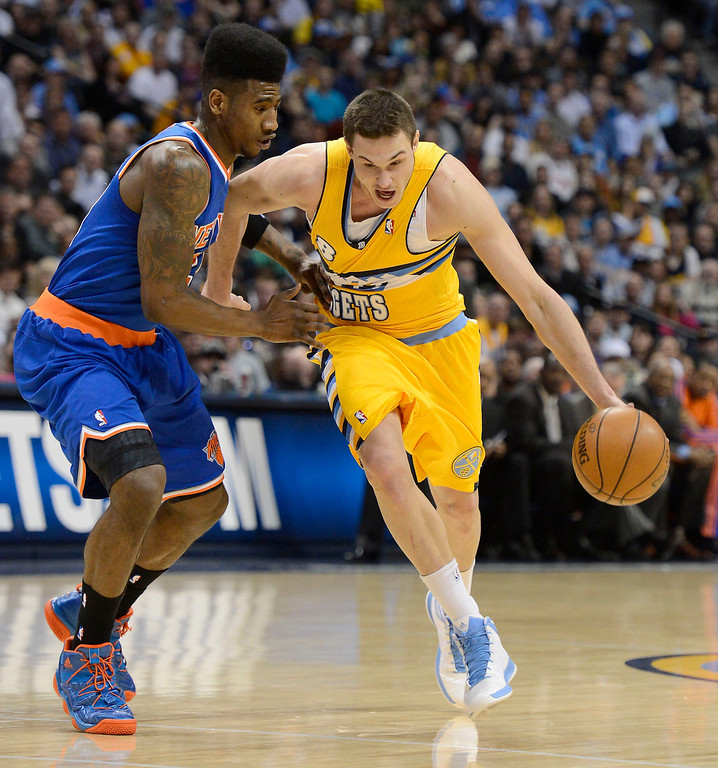 . Danilo Gallinari (8) of the Denver Nuggets drives on Iman Shumpert (21) of the New York Knicks during the first qurter March 13,  2013 at Pepsi Center. (Photo By John Leyba/The Denver Post)