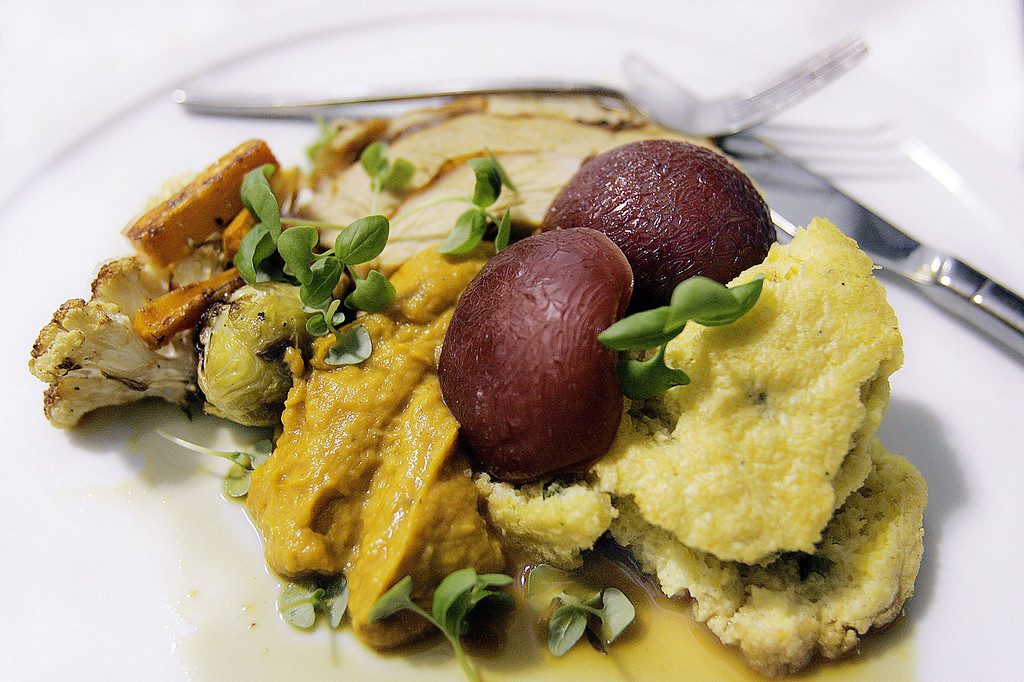 . A plated Thanksgiving entree prepared by chef Patricia Yeo is seen at her restaurant Sapa, Oct. 19, 2005 in New York. Ms. Yeo prepared a traditional dinner including roast turkey, sweet potato puree, roasted brussel sprouts, cauliflower and plums.  (AP Photo/Stephen Chernin)