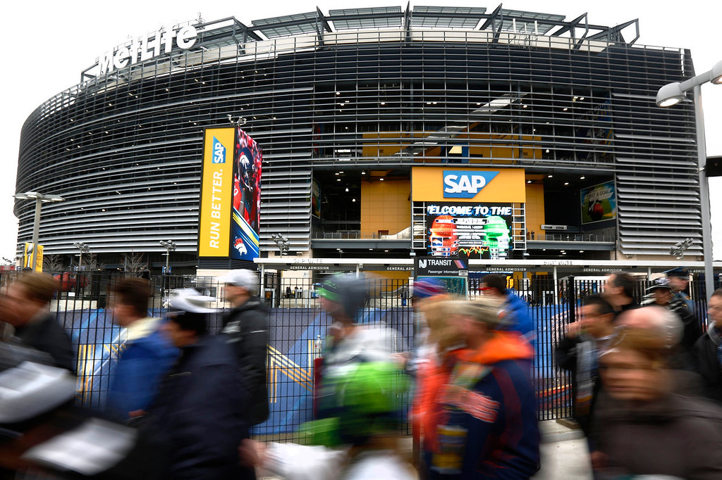 . Football fans arrive at MetLife Stadium, Sunday, Feb. 2, 2014, in East Rutherford, N.J. The Seattle Seahawks are scheduled to play the Denver Broncos in NFL football\'s Super Bowl XLVIII game on Sunday evening. (AP Photo/Matt Rourke)