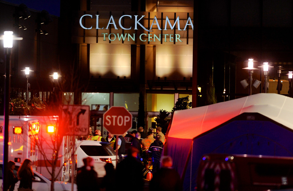 . Police and medics work the scene of a multiple shooting at Clackamas Town Center Mall in Clackamas, Ore., Tuesday Dec. 11, 2012. A gunman is dead after opening fire in the Portland, Ore., area shopping mall Tuesday, killing two people and wounding another, sheriff\'s deputies said. (AP Photo/Greg Wahl-Stephens)