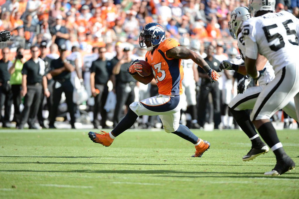 . The Broncos running back Willis McGahee makes a run in the third quarter during the Denver Broncos game against the Oakland Raiders at Sports Authority Field at Mile High on Sunday, September 30, 2012. Photo by John Leyba, The Denver Post