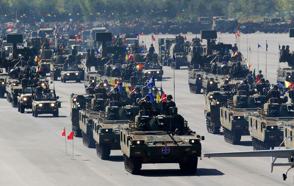 . South Korean mechanized unit personnel parade with their armored vehicles during the media day for the 65th anniversary of Armed Forces Day at Seoul military airport in Seongnam, South Korea, Friday, Sept. 27, 2013.   (AP Photo/Lee Jin-man)