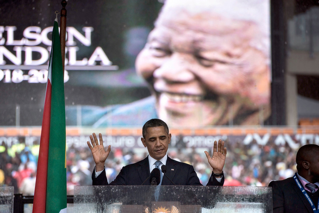. US President Barack Obama arrives to deliver a speech during the memorial service for late South African President Nelson Mandela at Soccer City Stadium in Johannesburg on December 10, 2013. Mandela, the revered icon of the anti-apartheid struggle in South Africa and one of the towering political figures of the 20th century, died in Johannesburg on December 5 at age 95. Mandela, who was elected South Africa\'s first black president after spending nearly three decades in prison, had been receiving treatment for a lung infection at his Johannesburg home since September, after three months in hospital in a critical state. BRENDAN SMIALOWSKI/AFP/Getty Images