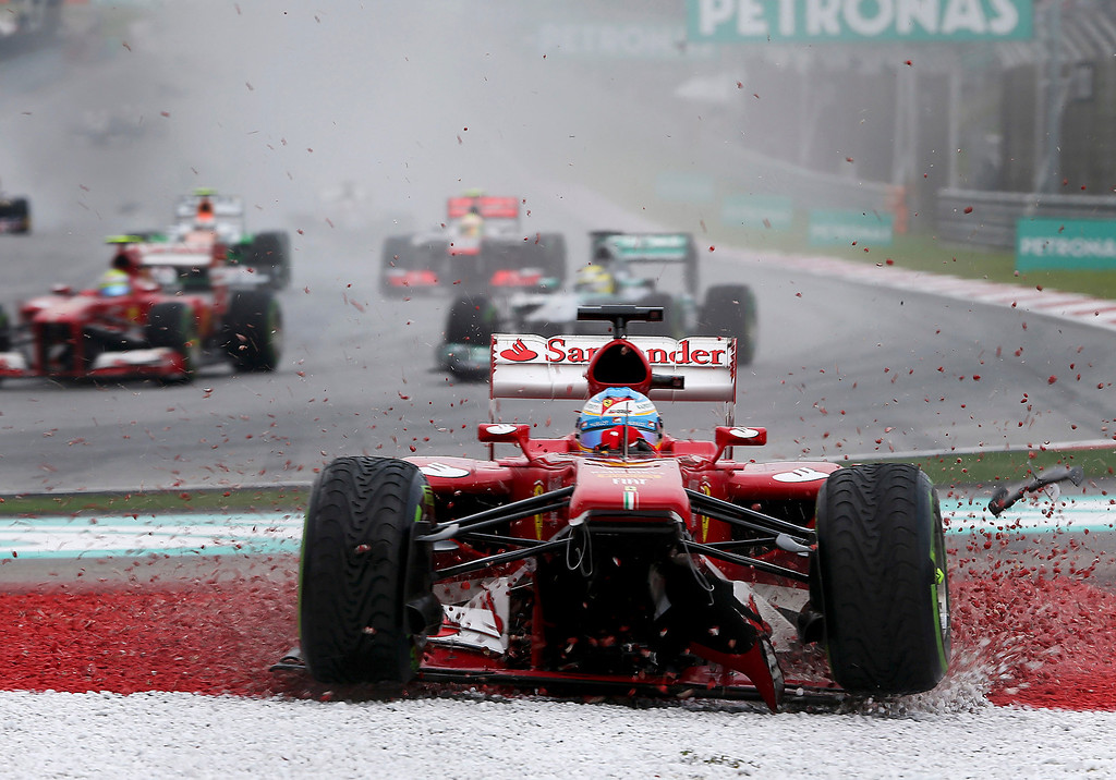 . Ferrari driver Fernando Alonso of Spain goes off the track during the Malaysian Formula One Grand Prix at Sepang, Malaysia, Sunday, March 24, 2013. (AP Photo, FIle)