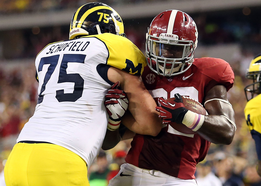 . ARLINGTON, TX - SEPTEMBER 01:  C.J. Mosley #32 of the Alabama Crimson Tide runs for a touchdown against Michael Schofield #75 of the Michigan Wolverines at Cowboys Stadium on September 1, 2012 in Arlington, Texas.  (Photo by Ronald Martinez/Getty Images)