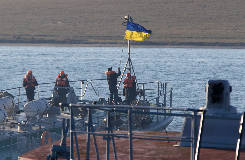 . Sailors raise national flag onboard Ukrainian navy\'s medium landing vessel Kirovohrad  as she arrives for her mooring at a lake Donuzlav near the town of Novo-Ozerne, Crimea, on Friday, March 21, 2014.  (AP Photo/Ivan Sekretarev)