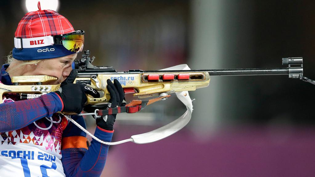 . Norway\'s Tiril Eckhoff shoots during the women\'s biathlon 12.5k mass-start, at the 2014 Winter Olympics, Monday, Feb. 17, 2014, in Krasnaya Polyana, Russia. (AP Photo/Lee Jin-man)