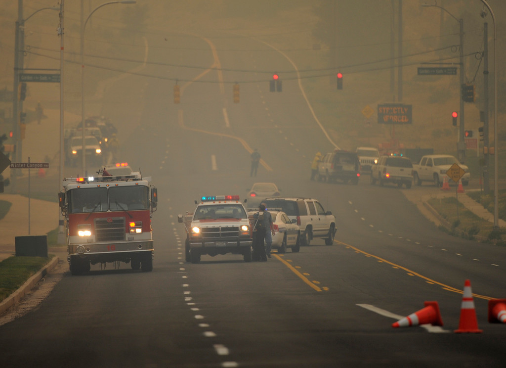. Authorities blocked Garden of the Gods Road at North 30th Street. Residents of the Lower Mountain Shadows subdivision evacuated the neighborhood in northwest Colorado Springs Tuesday evening, June 26, 2012. Flames from the Waldo Canyon fire jumped into Colorado Springs forcing emergency evacuations of some neighborhoods. Karl Gehring/The Denver Post