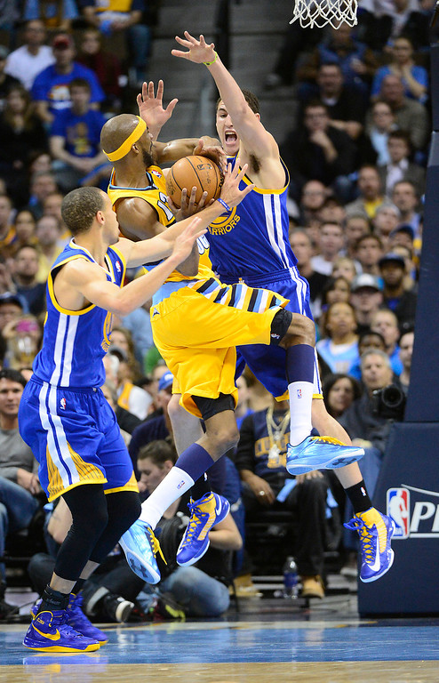 . DENVER, CO. - APRIL 23: Denver Nuggets small forward Corey Brewer (13) tries to put up a shot against Golden State Warriors shooting guard Klay Thompson (11) and Golden State Warriors point guard Stephen Curry (30) in the second quarter. The Denver Nuggets took on the Golden State Warriors in Game 2 of the Western Conference First Round Series at the Pepsi Center in Denver, Colo. on April 23, 2013. (Photo by AAron Ontiveroz/The Denver Post)