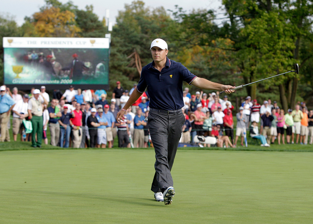 . United States team player Jordan Spieth celebrates his birdie putt on the 10th hole during a four-ball match at the Presidents Cup golf tournament at Muirfield Village Golf Club Thursday, Oct. 3, 2013, in Dublin, Ohio. Spieth and Steve Stricker won 1-up against the International team\'s Ernie Els and Brendon de Jonge. (AP Photo/Jay LaPrete)