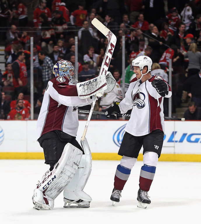 . Semyon Varlamov #1 (L) and Nick Holden #2 of the Colorado Avalanche celebrate a win over the Chicago Blackhawks at the United Center on January 14, 2014  in Chicago, Illinois. The Avalanche defeated the Blackhawks 3-2 in overtime. (Photo by Jonathan Daniel/Getty Images)