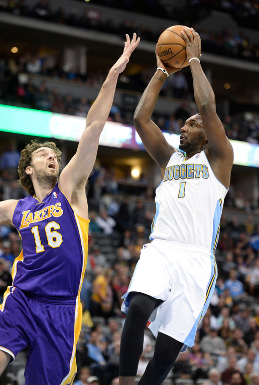 . DENVER, CO - NOVEMBER 13: Denver Nuggets small forward Jordan Hamilton (1) takes a shot over Los Angeles Lakers center Pau Gasol (16) during the second quarter November 13, 2013 at Pepsi Center. (Photo by John Leyba/The Denver Post)