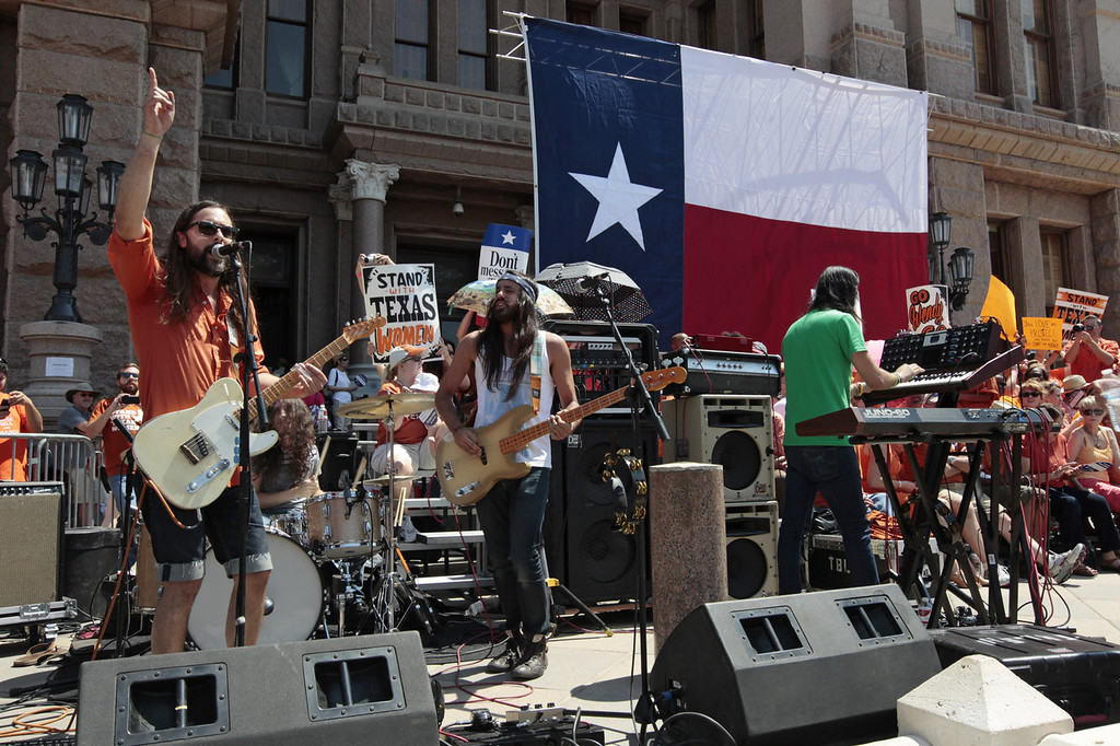 """. Austin rock group The Bright Light Social Hour sing their song \""""Wendy Davis\"""" during a rally in support of Texas women\'s right to reproductive decisions at the Texas State capitol on July 1, 2013 in Austin, Texas. This is first day of a second legislative special session called by Texas Gov. Rick Perry to pass a restrictive abortion law through the Texas legislature. The first attempt was defeated after opponents of the law were able to stall the vote until after the first special session had ended.  (Photo by Erich Schlegel/Getty Images)"""