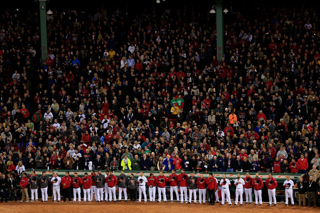 . The Boston Red Sox line up for the national anthem before Game Two of the 2013 World Series against the St. Louis Cardinals at Fenway Park on October 24, 2013 in Boston, Massachusetts.  (Photo by Jamie Squire/Getty Images)