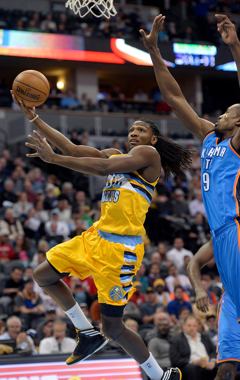 . Denver Nuggets power forward Kenneth Faried (35) goes up for a shot past Oklahoma City Thunder power forward Serge Ibaka (9) during the first quarter December 17, 2013 at Pepsi Center. (Photo by John Leyba/The Denver Post)