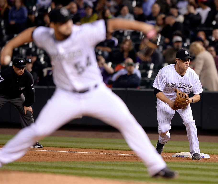 . Justin Morneau covered first base with Tommy Kahnle on the mound in the eighth inning. The Colorado Rockies hosted the San Francisco Giants Wednesday night, May 21, 2014.  (Photo by Karl Gehring/The Denver Post)