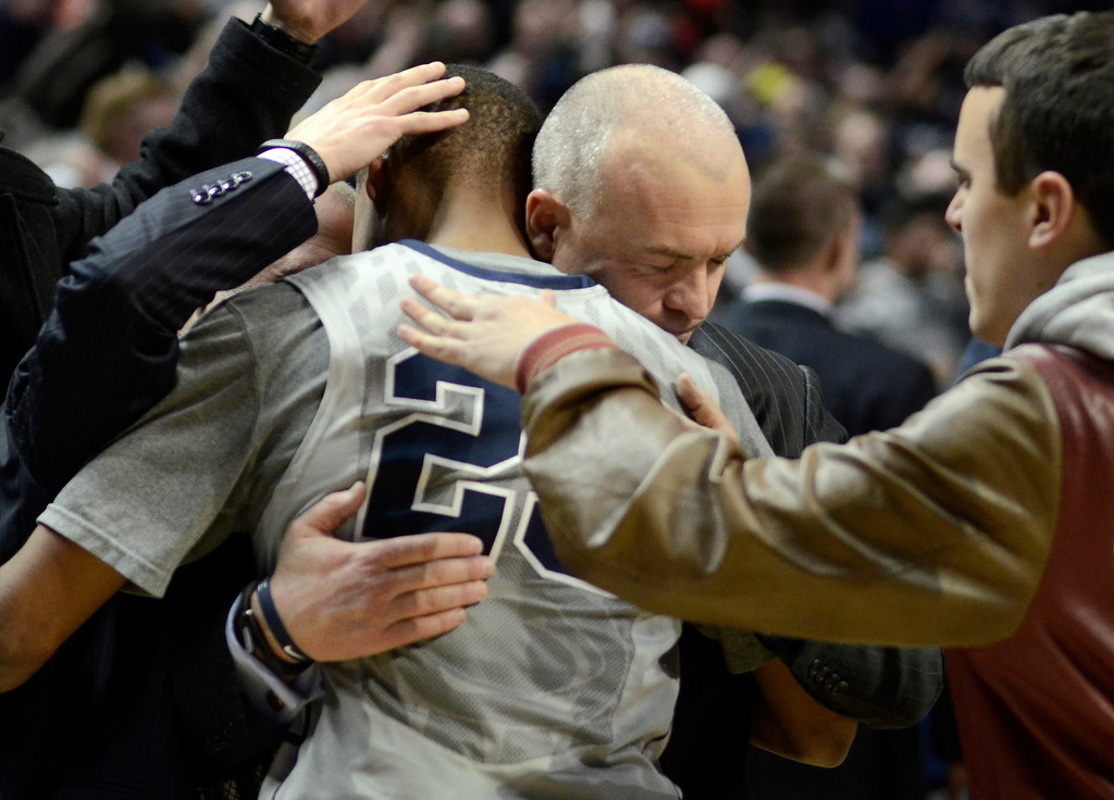 . Penn State head coach Patrick Chambers congratulates Tim Frazier and the end of their win over Ohio State in an NCAA college basketball game on Thursday, Feb. 27, 2014, in State College, Pa. Penn State won 65-63. (AP Photo/Ralph Wilson)
