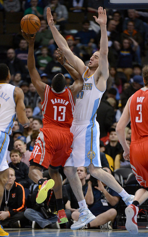 . DENVER, CO. - JANUARY 30: Houston Rockets shooting guard James Harden (13) runs in to Denver Nuggets center Kosta Koufos (41) as he drives to the basket during the first quarter January 30, 2013 at Pepsi Center. The Denver Nuggets take on the Houston Rockets in NBA action. (Photo By John Leyba/The Denver Post)