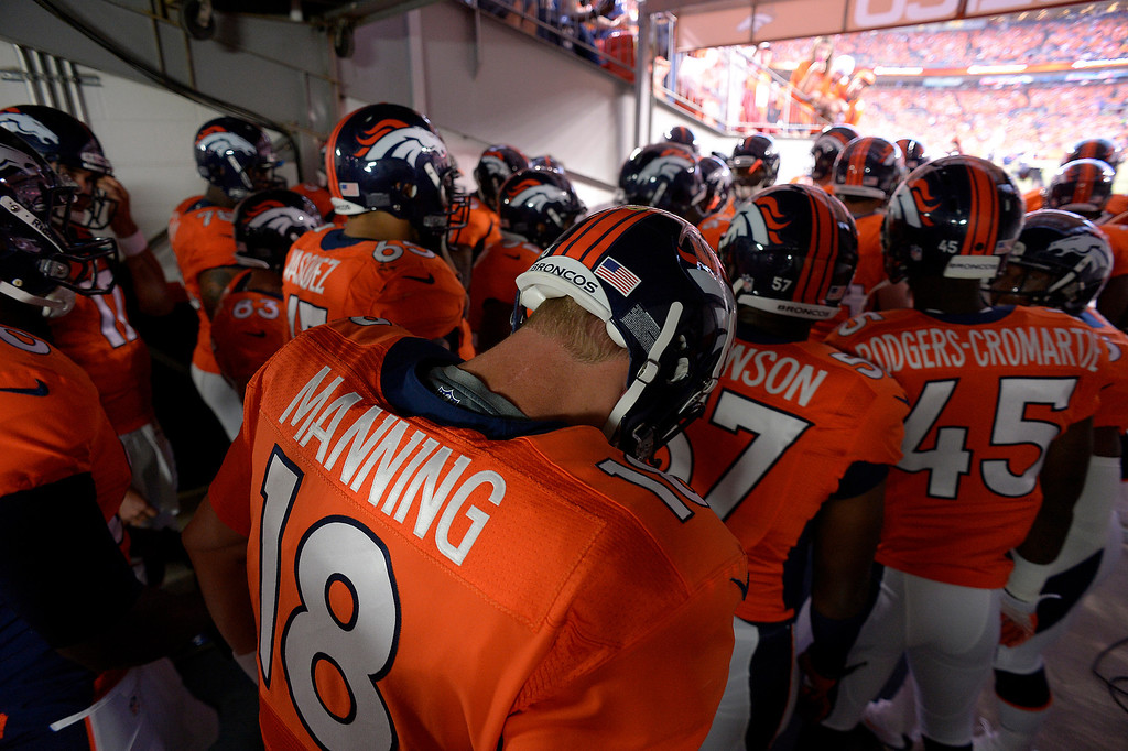 . DENVER, CO - SEPTEMBER 05: Denver Broncos quarterback Peyton Manning (18) waits to take the field before the game. The Denver Broncos took on the Baltimore Ravens in the first game of the 2013 season at Sports Authority Field at Mile High in Denver on September 5, 2013. (Photo by John Leyba/The Denver Post)