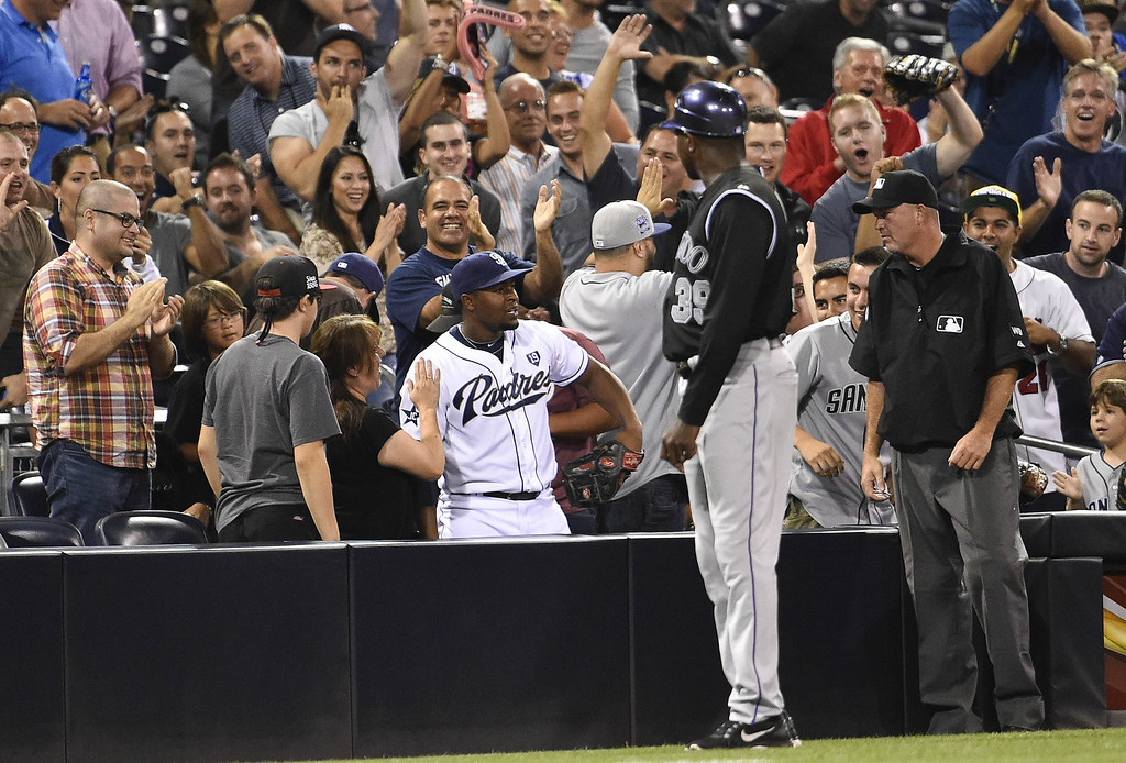 . SAN DIEGO, CA - AUGUST 12:  Chris Nelson #1 of the San Diego Padres gets an ovation from the crowd after he made the catch on a foul ball hit by Charlie Blackmon #19 of the Colorado Rockies during the eighth inning of a baseball game at Petco Park August, 12, 2014 in San Diego, California.  (Photo by Denis Poroy/Getty Images)