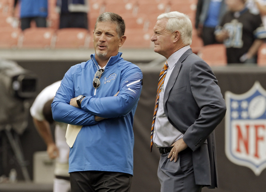 . Detroit Lions head coach Jim Schwartz, left, talks with Cleveland Browns owner Jimmy Haslam before an NFL football game Sunday, Oct. 13, 2013, in Cleveland. (AP Photo/Mark Duncan)