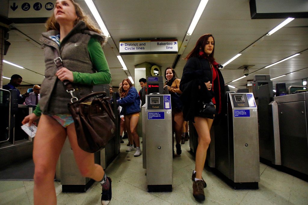 . People take part in a No Pants Day 2014 flash mob on the London Underground, in London, Britain, 12 January 2014. The event is organized by Improv Everywhere and takes place in many cities across the world. The goal for the participants is to get on public transport dressed in normal winter clothes, but without pants while keeping a straight face.  EPA/TAL COHEN