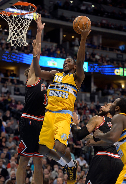 . Denver Nuggets power forward Kenneth Faried (35) drives to the basket on Chicago Bulls center Joakim Noah (13) during the first quarter November 21, 2013 at Pepsi Center. (Photo by John Leyba/The Denver Post)