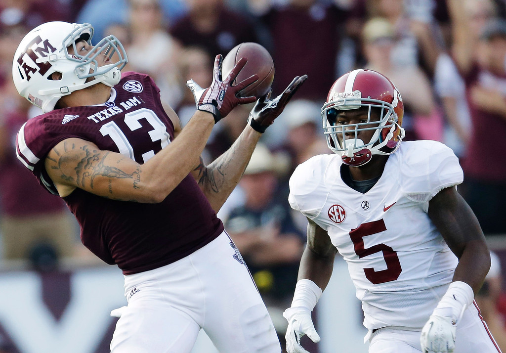 . In this Sept. 14, 2013, file photo, Texas A&M wide receiver Mike Evans (13) makes a 95-yard touchdown reception during the fourth quarter of an NCAA college football game in College Station, Texas. Evans was picked #7 overall by the Tampa Bay Buccaneers. (AP Photo/David J. Phillip, File)