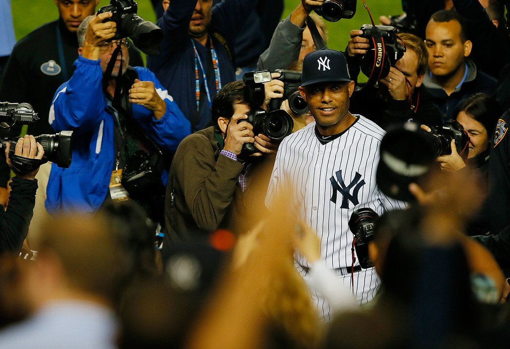 . NEW YORK, NY - SEPTEMBER 26:   Mariano Rivera #42 of the New York Yankees leaves the dugout and heads to the locker room after pitching his last game ever at Yankees Stadium after their game against the Tampa Bay Rays at Yankee Stadium on September 26, 2013 in the Bronx borough of New York City.  (Photo by Mike Stobe/Getty Images)