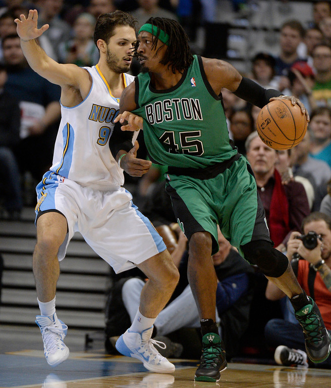 . Boston Celtics small forward Gerald Wallace (45) is guarded closely by Denver Nuggets shooting guard Evan Fournier (94) during the first quarter January 7, 2014 at Pepsi Center. (Photo by John Leyba/The Denver Post)